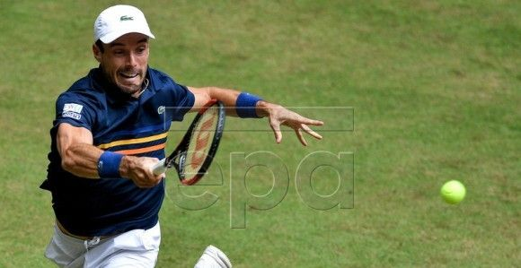 Roberto Bautista Agut of Spain in action during his semi final match against Borna Coric from Croatia at the ATP Tennis Tournament Gerry Weber Open in Halle, Germany, 23 June 2018. EPA-EFE/SASCHA STEINBACH