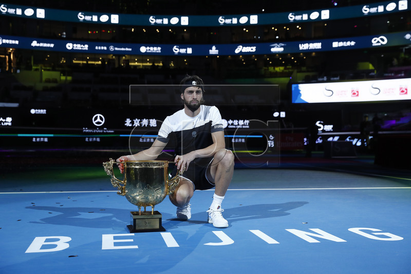 Nikoloz Basilashvili of Georgia poses with the trophy after winning his men's singles final match against Juan Martin Del Potro of Argentina at the China Open tennis tournament in Beijing, China, 07 October 2018. EPA-EFE/WU HONG