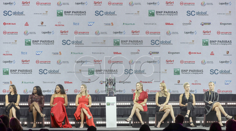 (L-R) Karolina Pliskova of the Czech Republic, Sloane Stephens of the USA, Naomi Osaka of Japan, Angelique Kerber of Germany, Caroline Wozniacki of Denmark, Petra Kvitova of the Czech Republic, Elina Svitolina of Ukraine, and Kiki Bertens of the Netherlands are pictured flanking the Billie Jean King Trophy during the singles draw ceremony for the BNP Paribas WTA Finals 2018 held at the Marina Bay Sands Hotel in Singapore, 19 October 2018. The BNP Paribas WTA Finals 2018 will take place from 21-28 October 2018 at the Singapore Indoor Stadium. EPA-EFE/WALLACE WOON