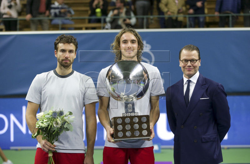 Greece's Stefanos Tsitsipas poses with his trophy and Sweden's Prince Daniel after winning the ATP Stockholm Open tennis tournament men's single final against Latvia's Ernests Gulbis (left) at the Royal Tennis Hall on October 21 2018, in Stockholm, Sweden. EPA-EFE/Soren Andersson/TT SWEDEN OUT