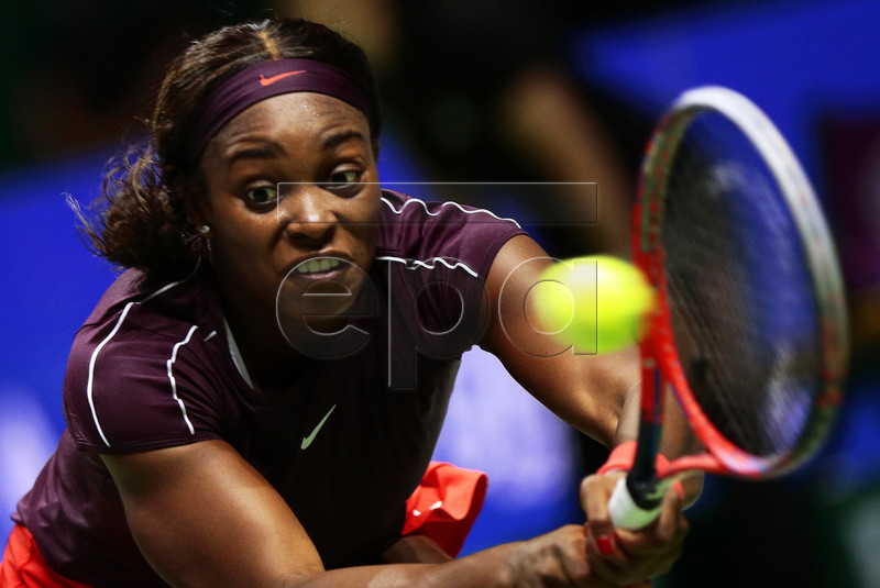 Sloane Stephens of the USA in action against Naomi Osaka of Japan during their singles round robin match of the BNP Paribas WTA Finals 2018 at the Indoor Stadium in Singapore, 22 October 2018. EPA-EFE/WALLACE WOON