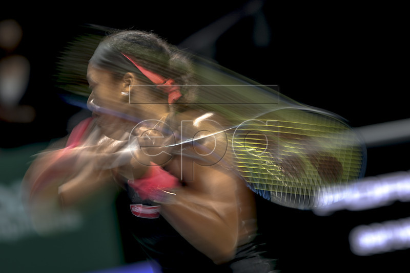 Naomi Osaka of Japan in action during her singles round robin match against Angelique Kerber of Germany at the BNP Paribas WTA Finals 2018 held at the Indoor Stadium in Singapore, 24 October 2018. EPA-EFE/WALLACE WOON