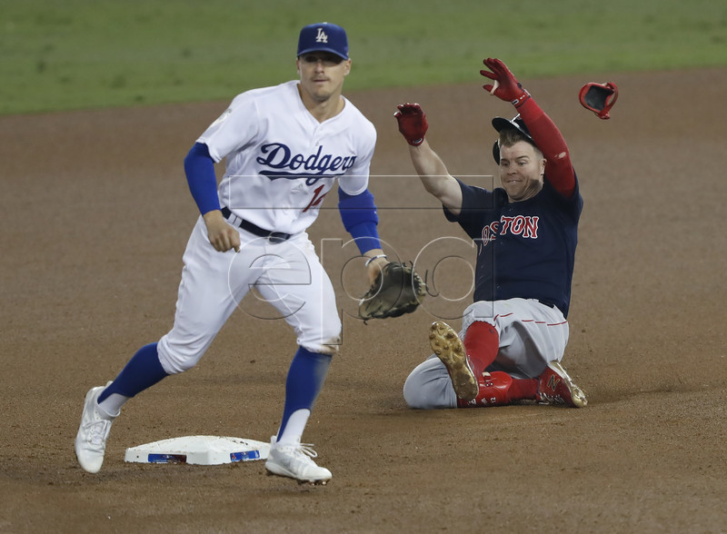 Boston Red Sox batter Brock Holt slides safely into second with a double against the Los Angeles Dodgers in the top of the ninth inning of game four of the World Series at Dodger Stadium in Los Angeles, California, USA, 27 October 2018. The Red Sox lead the best-of-seven series 2-1 to determine the champion of Major League Baseball. EPA-EFE/JOHN G. MABANGLO