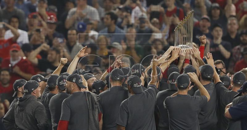 Boston Red Sox players celebrate with the Commissioner's Trophy after defeating the Los Angeles Dodgers in game five of the World Series at Dodger Stadium in Los Angeles, California, USA, 28 October 2018. The Red Sox win the series 4-1 to become the World Champions of Major League Baseball. EPA-EFE/JOHN G. MABANGLO
