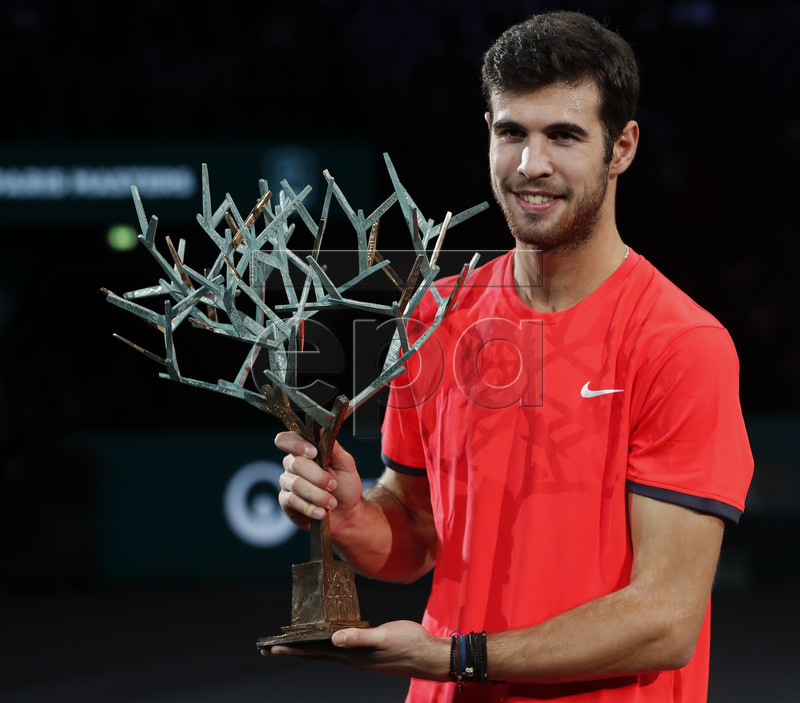 epa07141199 Karen Khachanov of Russia poses with the trophy after winning the final against Novak Djokovic of Serbia at the Rolex Paris Masters tennis tournament in Paris, France, 04 November 2018. EPA-EFE/IAN LANGSDON