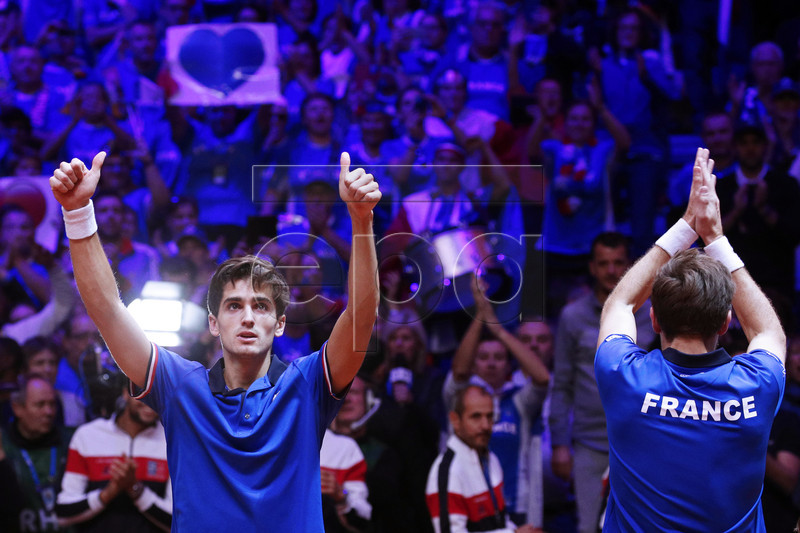 Pierre-Hugues Herbert (L) and Nicolas Mahut (R) of France celebrate after winning the doubles match against Ivan Dodig and Mate Pavic of Croatia at the Davis Cup Final between France and Croatia at the Pierre Mauroy Stadium in Villeneuve-d'Ascq, near Lille, France, 24 November 2018. EPA-EFE/YOAN VALAT