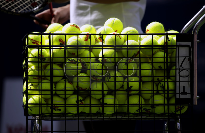 A basket of tennis balls for practice on Kids Day at the USTA Billie Jean King National Tennis Center in Flushing Meadows, in New York, New York ,USA, 29 August 2015. EPA/PETER FOLEY