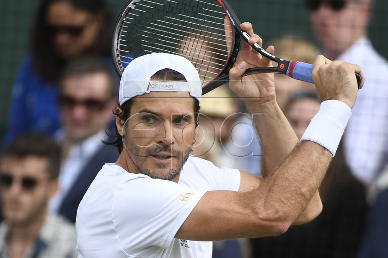 Tommy Haas of Germany in action against Rafael Nadal of Spain during their exhibition tennis match at the Aspall Tennis Classic at the Hurlingham Club in London, Britain, 30 June 2017. EPA/WILL OLIVER