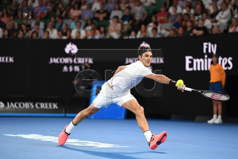 Roger Federer of Switzerland in action during his men's singles final match against Marin Cilic of Croatia at the Australian Open Grand Slam tennis tournament in Melbourne, Australia, 28 January 2018. EPA-EFE/LUKAS COCH AUSTRALIA AND NEW ZEALAND OUT