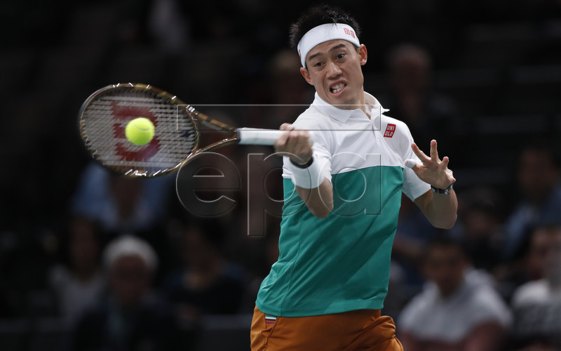 Kei Nishikori of Japan returns the ball to Adrian Mannarino of France during their second round match at the Rolex Paris Masters tennis tournament in Paris, France, 31 0ctober 2018. EPA-EFE/IAN LANGSDON