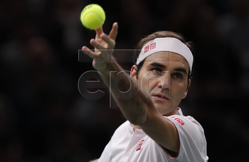 Roger Federer of Switzerland serves the ball to Novak Djokovic of Serbia during their semifinal match at the Rolex Paris Masters tennis tournament in Paris, France, 03 November 2018. EPA-EFE/CHRISTOPHE PETIT TESSON