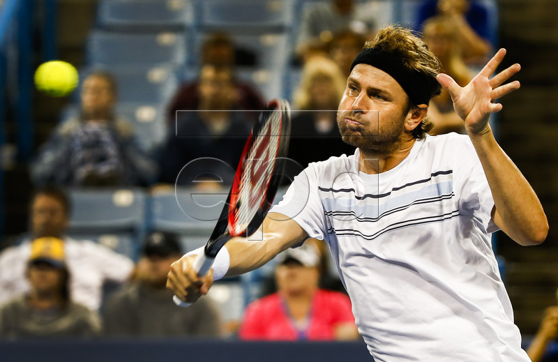 Mardy Fish of the US hits a return shot to Andy Murray of Great Britain during their second round match in the Western and Southern Open at the Linder Family Tennis Center in Mason, Ohio, USA, 19 August 2015. EPA/TANNEN MAURY