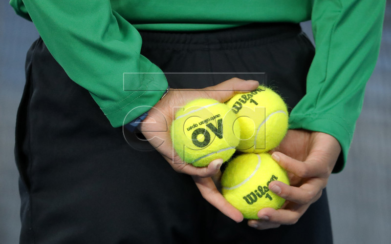 epa05748746 Official tennis balls are hold by a ball kid during the match Rafael Nadal of Spain against Milos Raonic of Canada in the Men's Singles quarter-finals at the Australian Open Grand Slam tennis tournament in Melbourne, Victoria, Australia, 25 January 2017. EPA/Made Nagi
