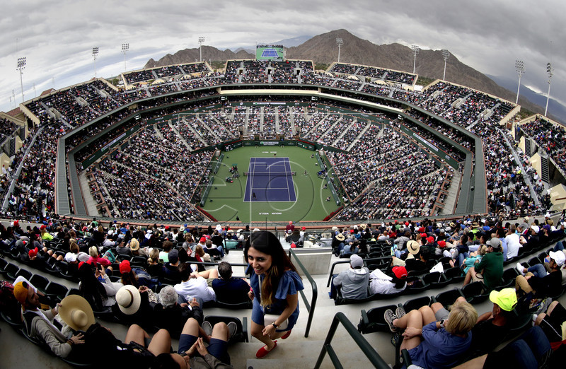 A fan makes her way to her seat in Stadium 1 during the Serena Williams-Kiki Bertens match during the BNP Paribas Open at the Indian Wells Tennis Garden in Indian Wells, California, USA, 10 March 2018. EPA-EFE/MIKE NELSON