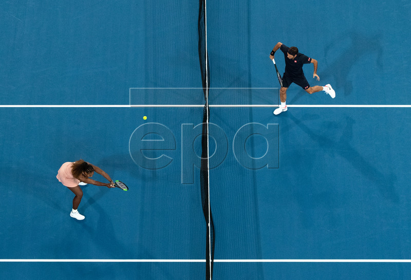 Serena Williams (L) of the USA and Roger Federer (R) of Switzerland in action during the mixed doubles match between Roger Federer and Belinda Bencic of Switzerland and Frances Tiafoe and Serena Williams of the USA on day 4 of the Hopman Cup tennis tournament at RAC Arena in Perth, Western Australia, Australia, 01 January 2019. EPA-EFE/RICHARD WAINWRIGHT AUSTRALIA AND NEW ZEALAND OUT EDITORIAL USE ONLY