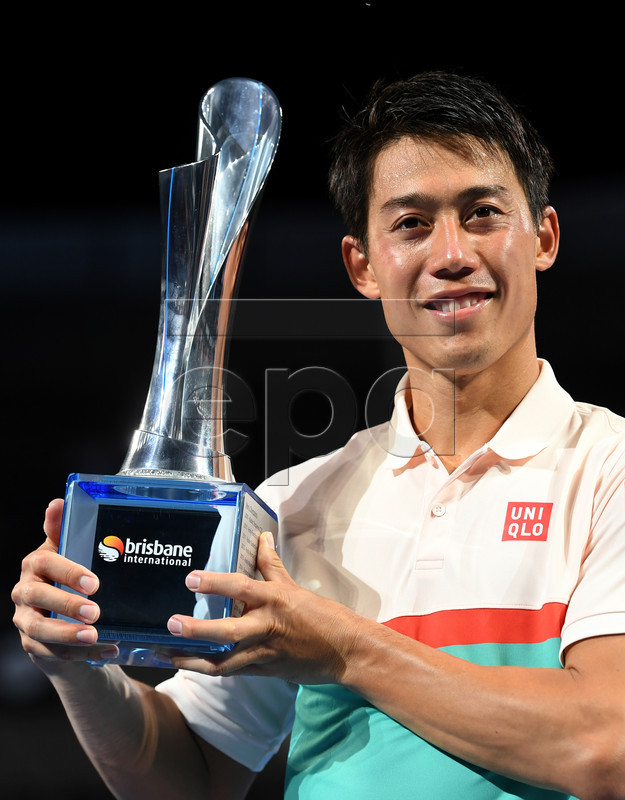 Kei Nishikori of Japan poses with his trophy after winning his Men's singles final match against Daniil Medvedev of Russia at the Brisbane International tennis tournament at the Queensland Tennis Centre in Brisbane, Australia, 06 January 2019. EPA-EFE/DAN PELED EDITORIAL USE ONLY AUSTRALIA AND NEW ZEALAND OUT