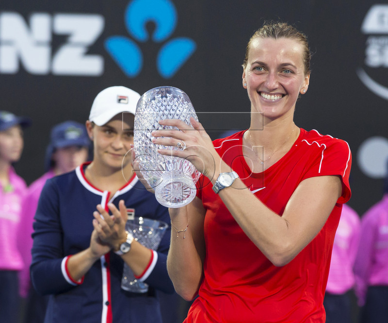 Petra Kvitova (R) of the Czech Republic poses with her trophy after defeating Ashleigh Barty (L) of Australia in their women's singles final of the Sydney International tennis tournament at Sydney Olympic Park Tennis Centre in Sydney, Australia, 12 January 2019. EPA-EFE/CRAIG GOLDING AUSTRALIA AND NEW ZEALAND OUT