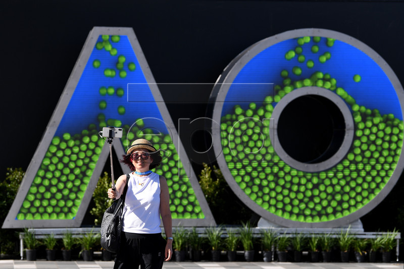 A visitor poses for photo during the Australian Open tennis tournament practice day in Melbourne, Australia, 13 January 2019. EPA-EFE/LUKAS COCH EDITORIAL USE ONLY AUSTRALIA AND NEW ZEALAND OUT
