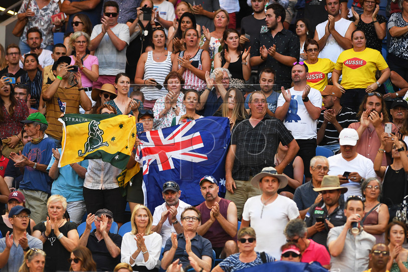 Australian fans cheer during the women's singles first round match between Ashleigh Barty of Australia and Luksika Kumkhum of Thailand at the Australian Open tennis tournament in Melbourne, Australia, 14 January 2019. EPA-EFE/LUKAS COCH AUSTRALIA AND NEW ZEALAND OUT