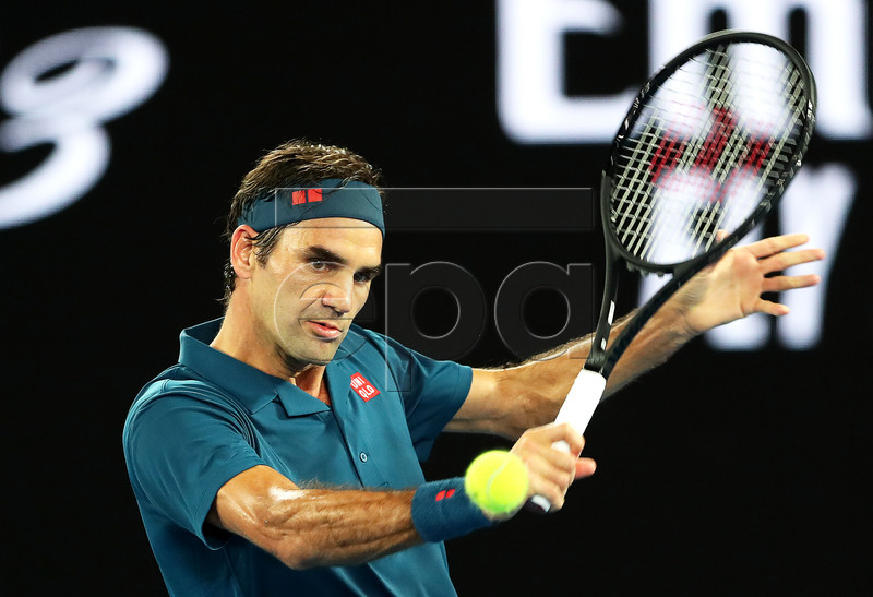 Roger Federer of Switzerland in action against Denis Istomin of Uzbekistan during their men's first round match at the Australian Open Grand Slam tennis tournament in Melbourne, Australia, 14 January 2019. EPA-EFE/DAVID CROSLING AUSTRALIA AND NEW ZEALAND OUT