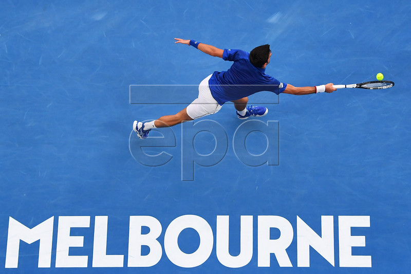 Novak Djokovic of Serbia in action against Mitchell Krueger of the USA during their men's first round match at the Australian Open tennis tournament in Melbourne, Australia, 15 January 2019. EPA-EFE/LUKAS COCH AUSTRALIA AND NEW ZEALAND OUT