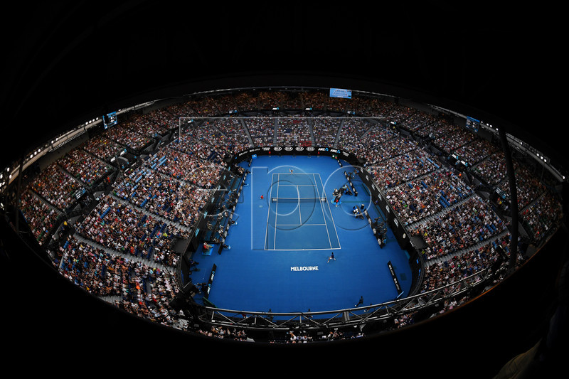 Picture taken with a fisheye lens of a general view of the Rod Laver Arena during the men's singles first round match between Novak Djokovic (front) of Serbia and Mitchell Krueger (back) of the USA at the Australian Open Grand Slam tennis tournament in Melbourne, Australia, 15 January 2019. EPA-EFE/LUKAS COCH AUSTRALIA AND NEW ZEALAND OUT