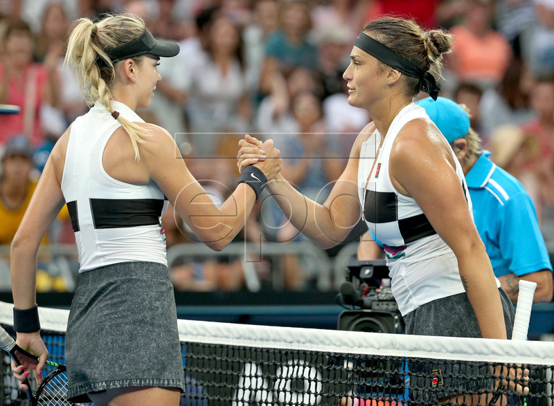 Katie Boulter of Great Britain (L) shakes hands with Aryna Sabalenka of Belarus at the net after their match during day three of the Australian Open tennis tournament in Melbourne, Victoria, Australia, 16 January 2019. Sabalenka won the match. EPA-EFE/HAMISH BLAIR AUSTRALIA AND NEW ZEALAND OUT