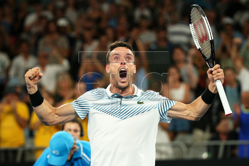 Roberto Bautista Agut of Spain celebrates after defeating John Millman of Australia in their men's second round match at the Australian Open tennis tournament in Melbourne, Australia, 16 January 2019. EPA-EFE/HAMISH BLAIR AUSTRALIA AND NEW ZEALAND OUT