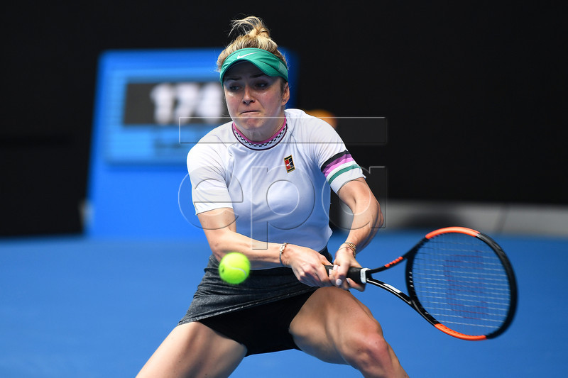 Elina Svitolina of Ukraine in action against Viktoria Kuzmova of Slovakia during their second round match on day four of the Australian Open tennis tournament in Melbourne, Australia, 17 January 2019. EPA-EFE/DAVID CROSLING AUSTRALIA AND NEW ZEALAND OUT