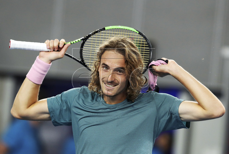 Stefanos Tsitsipas of Greece celebrates after defeating Nikoloz Basilashvili of Georgia during their round three men's singles match at the Australian Open Grand Slam tennis tournament in Melbourne, Australia, 18 January 2019. EPA-EFE/DAVID CROSLING AUSTRALIA AND NEW ZEALAND OUT
