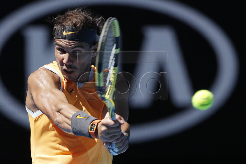 Rafael Nadal of Spain in action against Tomas Berdych of Czech Republic during their round four men's singles match at the Australian Open Grand Slam tennis tournament in Melbourne, Australia, 20 January 2019. EPA-EFE/RITCHIE TONGO