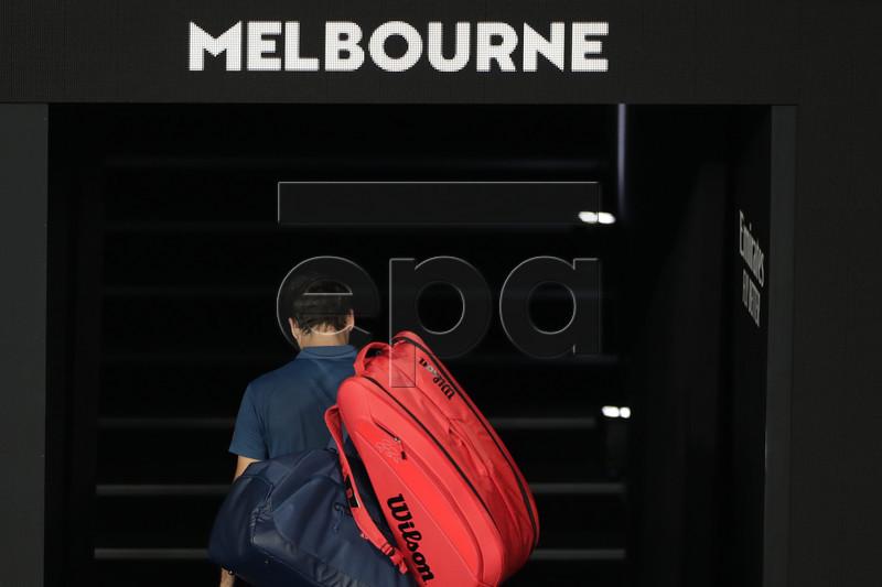 Roger Federer of Switzerland leaves the court on being defeated in his round four men's singles match against Stefanos Tsitsipas of Greece at the Australian Open Grand Slam tennis tournament in Melbourne, Australia, 20 January 2019. EPA-EFE/LYNN BO BO