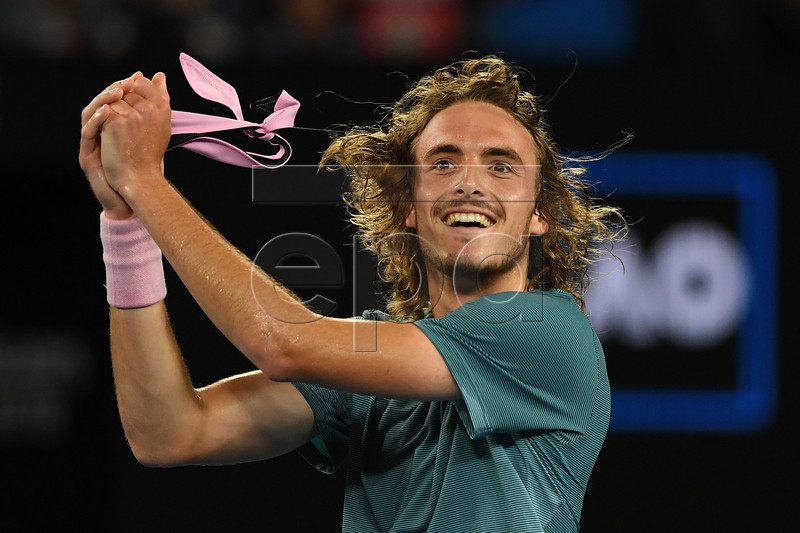 Stefanos Tsitsipas of Greece celebrates winning his men's singles fourth round match against Roger Federer of Switzerland at the Australian Open Grand Slam tennis tournament in Melbourne, Australia, 20 January 2019. EPA-EFE/LUKAS COCH AUSTRALIA AND NEW ZEALAND OUT