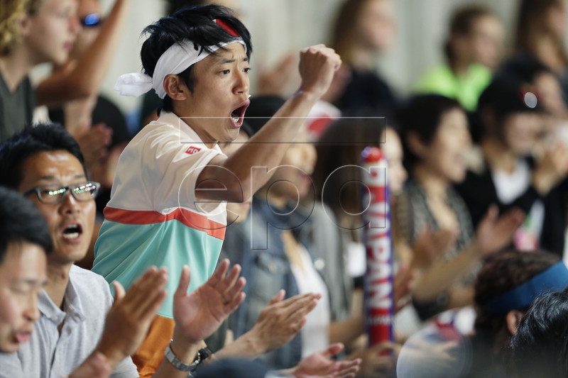 Fans of Kei Nishikori of Japan cheer during his men's singles fourth round match against Pablo Carreno Busta of Spain at the Australian Open Grand Slam tennis tournament in Melbourne, Australia, 21 January 2019. EPA-EFE/RITCHIE TONGO