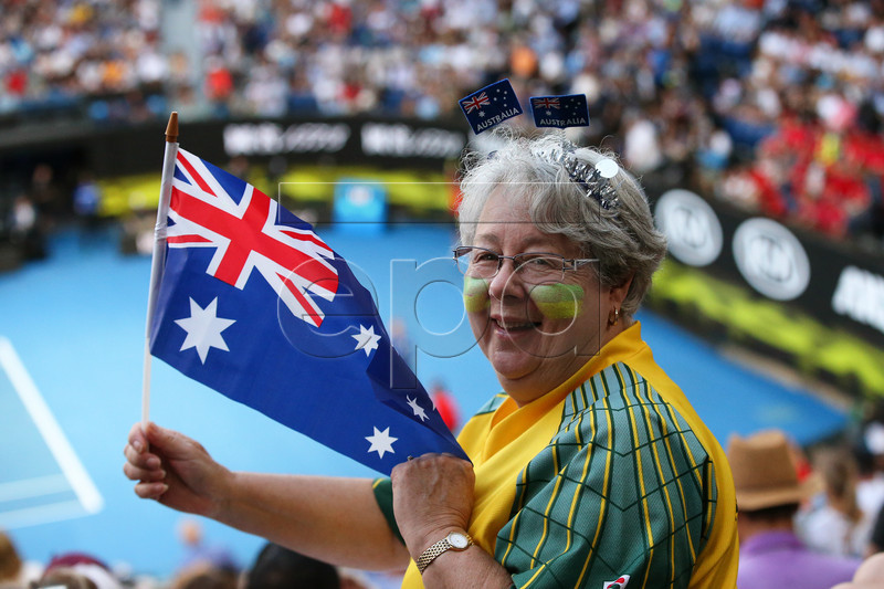 An Australian fan holds up a flag during the women's singles quarter final match between Petra Kvitova of the Czech Republic and Ashleigh Barty of Australia at the Australian Open Grand Slam tennis tournament in Melbourne, Australia, 22 January 2019. EPA-EFE/DAVID CROSLING AUSTRALIA AND NEW ZEALAND OUT