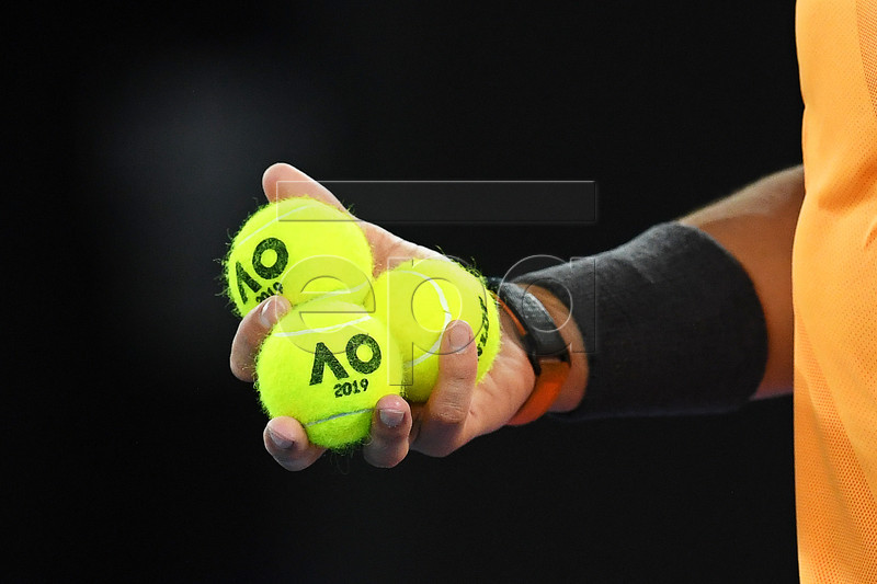 Rafael Nadal of Spain holds tennis balls during his men's singles quarter final match against Frances Tiafoe of the USA at the Australian Open Grand Slam tennis tournament in Melbourne, Australia, 22 January 2019. EPA-EFE/LUKAS COCH AUSTRALIA AND NEW ZEALAND OUT