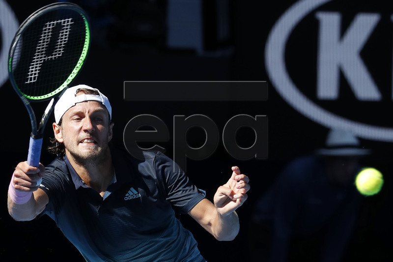 Lucas Pouille of France in action against Milos Raonic of Canada during their men's singles quarterfinals match at the Australian Open Grand Slam tennis tournament in Melbourne, Australia, 23 January 2019. EPA-EFE/RITCHIE TONGO