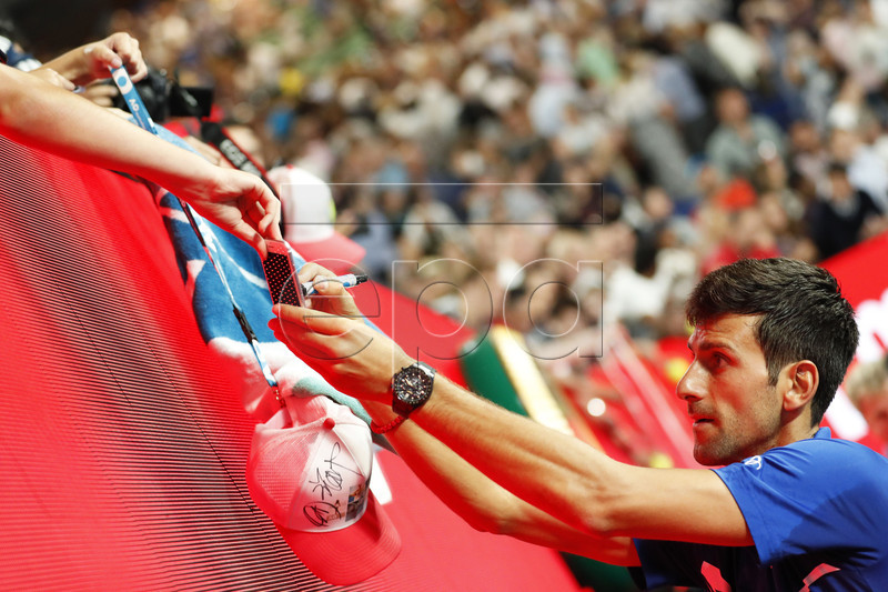 Novak Djokovic of Serbia signs autographs after winning his men's singles semi final match against Lucas Pouille of France at the Australian Open Grand Slam tennis tournament in Melbourne, Australia, 25 January 2019. EPA-EFE/RITCHIE TONGO