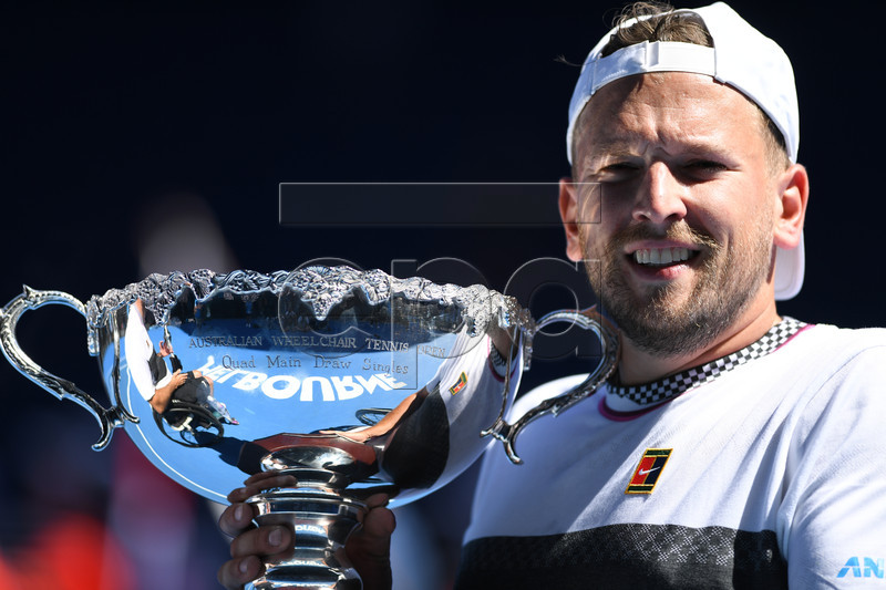 Dylan Alcott of Australia holds his trophy after winning the quad wheelchair singles final against David Wagner of the United States on day 13 of the Australian Open Grand Slam tennis tournament in Melbourne, Australia, 26 January 2019. EPA-EFE/LUKAS COCH EDITORIAL USE ONLY AUSTRALIA AND NEW ZEALAND OUT