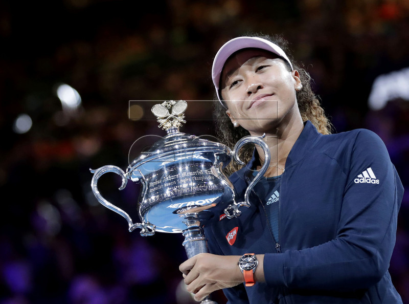 Naomi Osaka of Japan poses for photos with her trophy after winning the women's singles final match against Petra Kvitova of Czech Republic at the Australian Open Grand Slam tennis tournament in Melbourne, Australia, 26 January 2019. EPA-EFE/MAST IRHAM