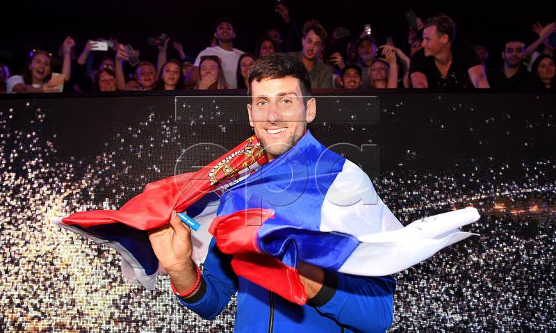 Novak Djokovic of Serbia celebrates winning his men's singles final match against Rafael Nadal of Spain at the Australian Open Grand Slam tennis tournament in Melbourne, Australia, 27 January 2019. EPA-EFE/JULIAN SMITH EDITORIAL USE ONLY AUSTRALIA AND NEW ZEALAND OUT