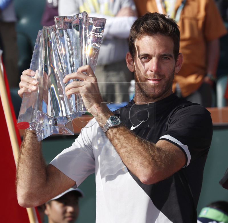 Juan Martin Del Potro of Argentina hoist the trophy during the BNP Paribas Open Finals ceremony after defeating Roger Federer of Switzerland at the Indian Wells Tennis Garden in Indian Wells, California, USA, 18 March 2018. EPA-EFE/JOHN G. MABANGLO