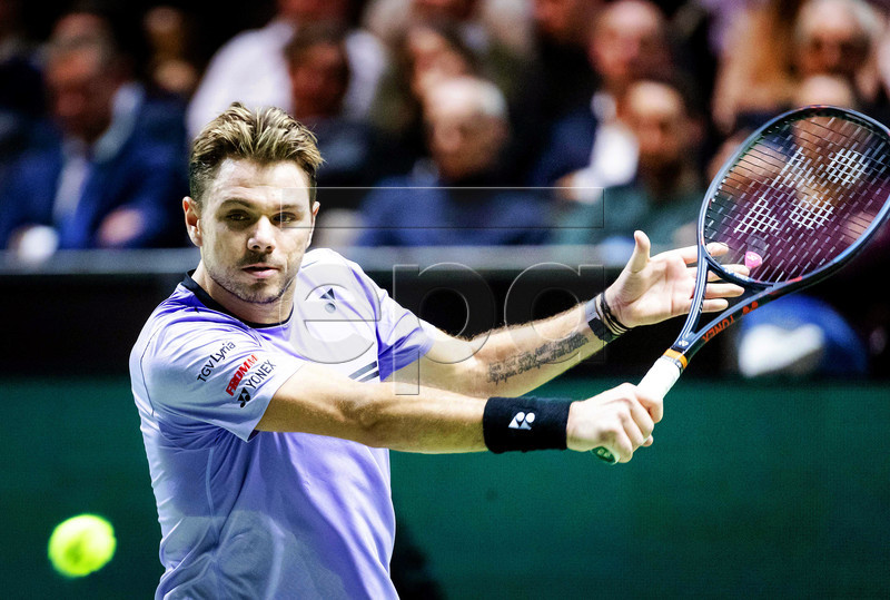 Stan Wawrinka of Switzerland in action against Benoit Paire of France during their first round match at the ABN AMRO World Tennis Tournament in Rotterdam, Netherlands, 11 February 2019. EPA-EFE/ROBIN VAN LONKHUIJSEN