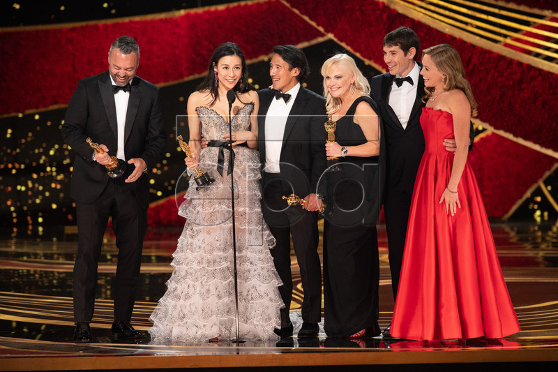 A handout photo made available by the Academy of Motion Picture Arts and Science (AMPAS) shows Evan Hayes, Elizabeth Chai Vasarhelyi, Jimmy Chin, and Shannon Dill accept the Oscar for best documentary feature during the 91st annual Academy Awards ceremony at the Dolby Theatre in Hollywood, California, USA, 24 February 2019. The Oscars are presented for outstanding individual or collective efforts in 24 categories in filmmaking. EPA-EFE/Aaron Poole / AMPAS / HANDOUT THE IMAGE MAY NOT BE ALTERED AND IS FREE FOR EDITORIAL USE ONY IN REPORTING ABOUT THE EVENT. ONE TIME USE ONLY. MANDATORY CREDIT. HANDOUT EDITORIAL USE ONLY/NO SALES