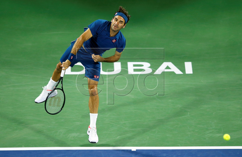 Roger Federer of Switzerland in action against Philipp Kohlschreiber of Germany during their first round match at the Dubai Duty Free Tennis ATP Championships 2019 in Dubai, United Arab Emirates, 25 February 2019. EPA-EFE/ALI HAIDER