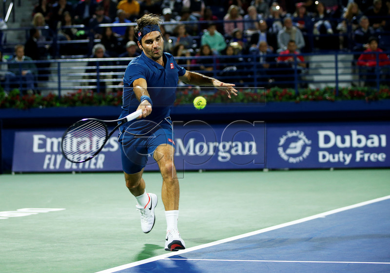 Roger Federer of Switzerland in action against Fernando Verdasco of Spain during their second round match at the Dubai Duty Free Tennis ATP Championships 2019 in Dubai, United Arab Emirates, 27 February 2019. EPA-EFE/ALI HAIDER