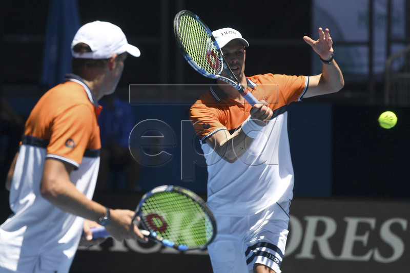 Bob Bryan (L) and Mike Bryan of the USA in action against Max Mirnyi of Belarus and Philipp Oswald of Austria during round two on day five of the Australian Open tennis tournament, in Melbourne, Victoria, Australia, 19 January 2018. EPA-EFE/JOE CASTRO AUSTRALIA AND NEW ZEALAND OUT