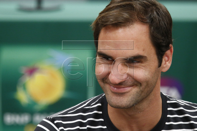 Roger Federer (C) of Switzerland speaks during the BNP Paribas Open Media Day round table at the Indian Well Tennis Garden in Indian Wells, California, USA, 06 March 2019. The men's and women's final will be played on 17 March 2019. EPA-EFE/LARRY W. SMITH