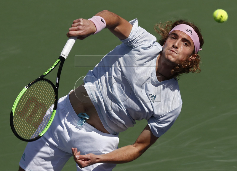 Stefanos Tsitsipas of Greece in action against Felix Auger-Aliassime of Canada during the BNP Paribas Open tennis tournament at the Indian Wells Tennis Garden in Indian Wells, California, USA, 09 March 2019. The men's and women's final will be played, 17 March 2019. EPA-EFE/LARRY W. SMITH