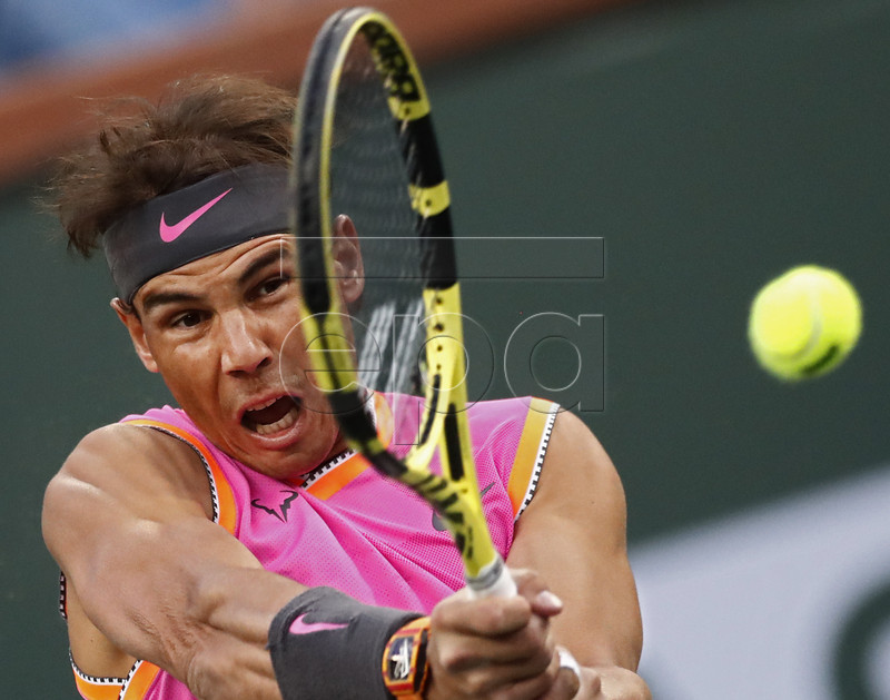Rafael Nadal of Spain in action against Jared Donaldson of United States during the BNP Paribas Open tennis tournament at the Indian Wells Tennis Garden in Indian Wells, California, USA, 10 March 2019. The men's and women's final will be played, 17 March 2019. EPA-EFE/LARRY W. SMITH